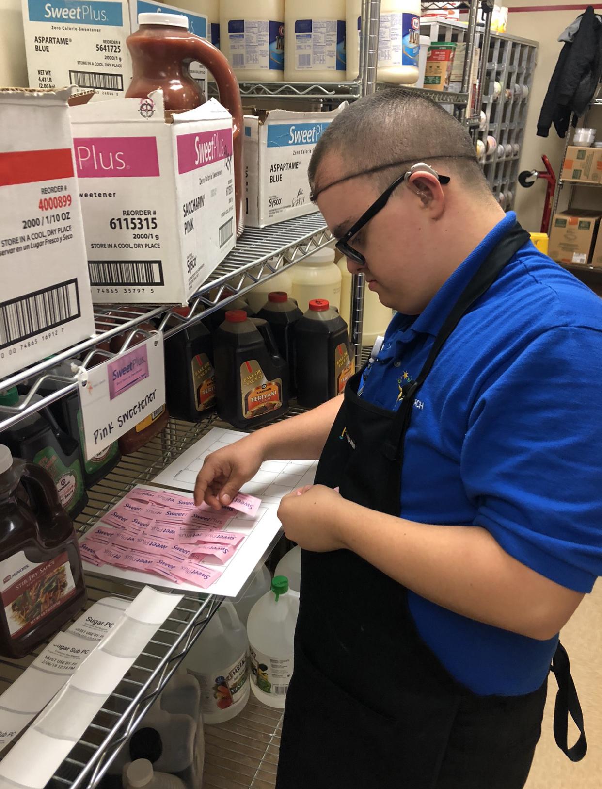 Man sorting sugar packets
